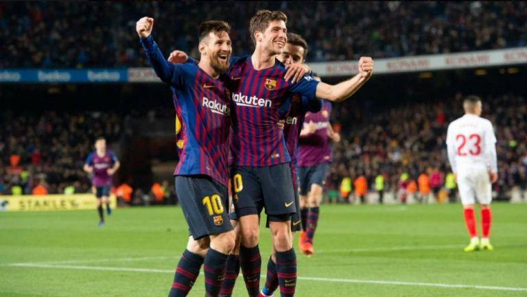 Messi y Sergi Roberto festejan un gol con el Barcelona