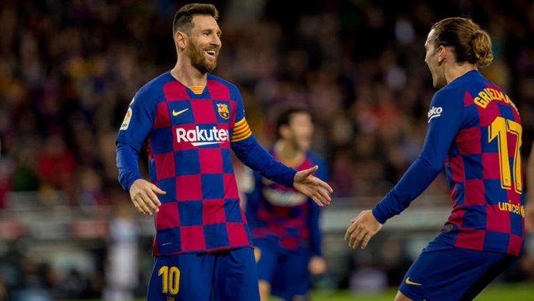 Messi y Griezmann celebran un tanto del Barcelona