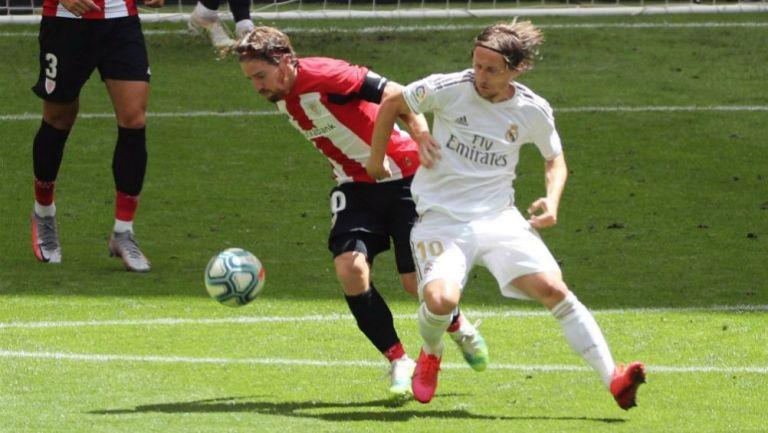 El capitán del Athletic Club Iker Muniain y Luka Modric