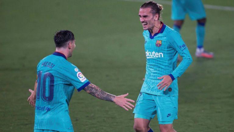 Messi y Griezmann en celebración con Barcelona