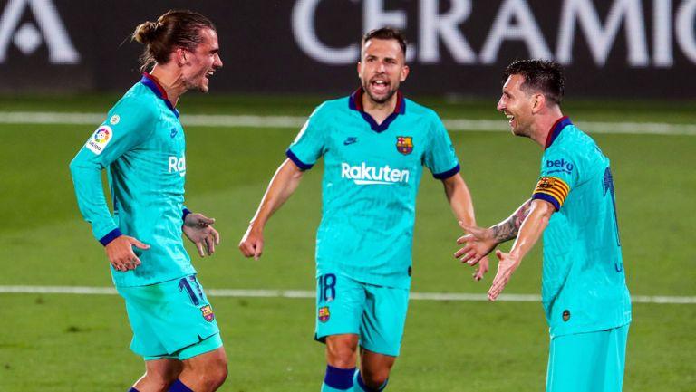 Griezmann festeja un gol con Lionel Messi en LaLiga