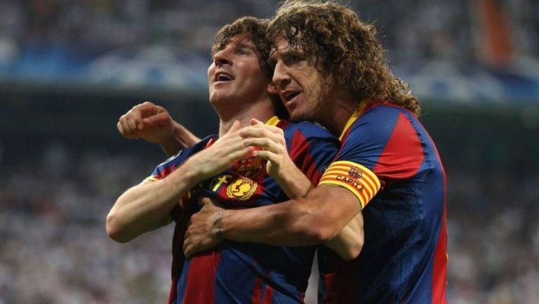Messi y Puyol juntos durante un partido de Barcelona