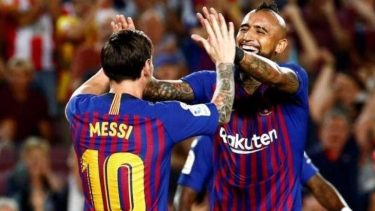 Messi y Vidal en un partido