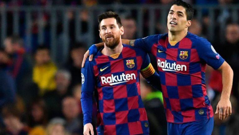 Suárez y Messi durante un duelo con el Barcelona
