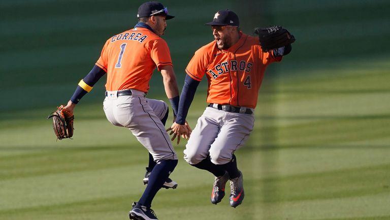 Springer y Correa celebran el triunfo