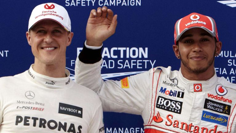 Michael Schumacher y Lewis Hamilton tras una carrera