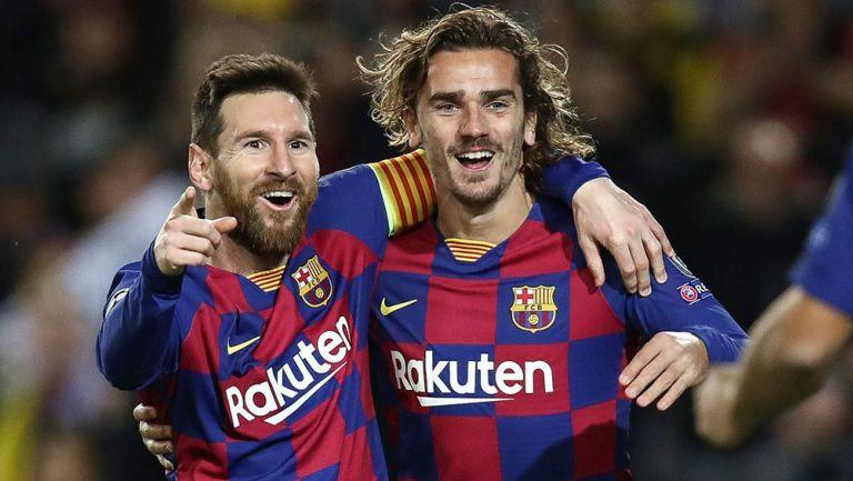 Griezmann y Messi festejan un gol en Barcelona