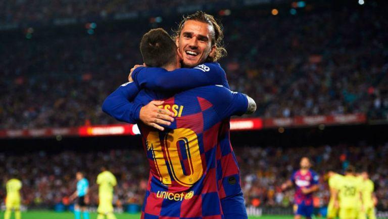 Messi y Griezmann en festejo