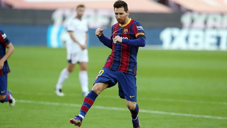 Leo Messi festeja un gol con Barcelona