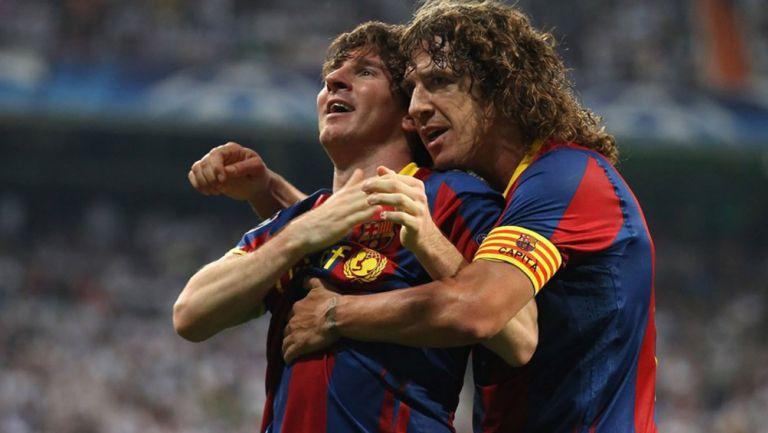 Puyol y Messi celebran una anotación del Barça