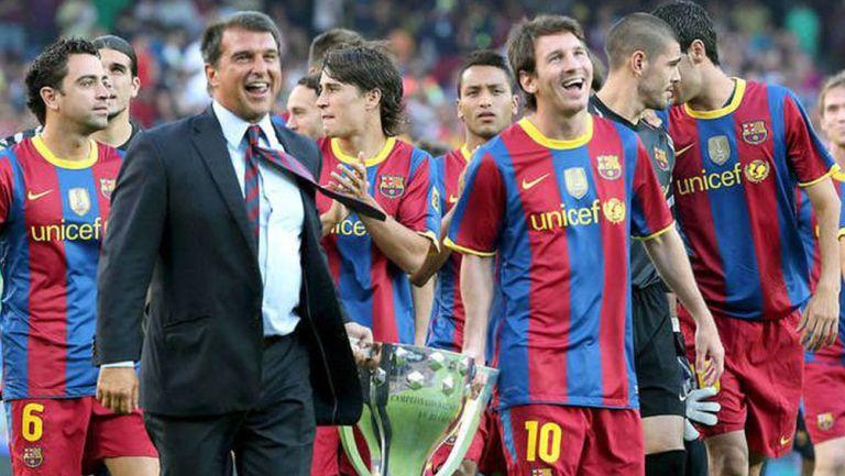 Laporta y Messi tras un título del Barcelona