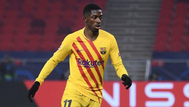 Ousmane Dembélé durante un duelo con el Barcelona