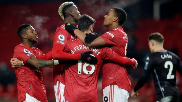 Jugadores de Manchester United en festejo