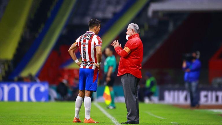 Vucetich y Molina durante un partido con Chivas