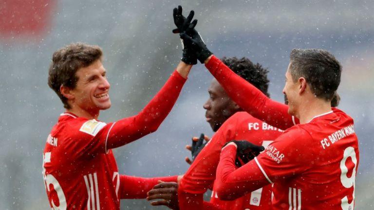 Thomas Müller y Robert Lewandowski celebrando un gol conseguido