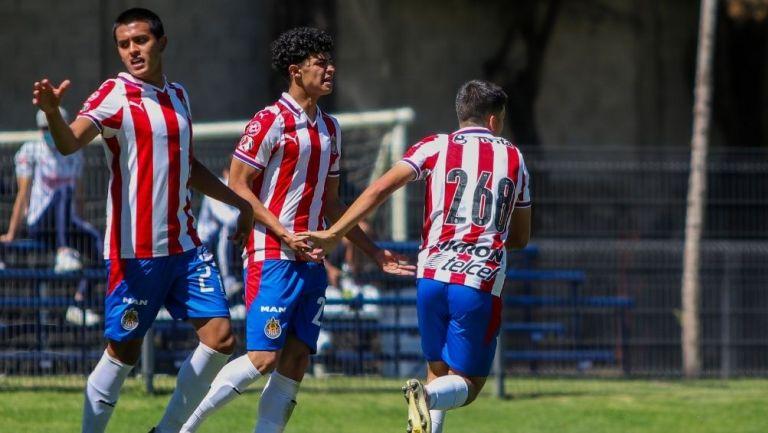 Carlos Salcido y Christo Vela festejan un gol del Rebaño