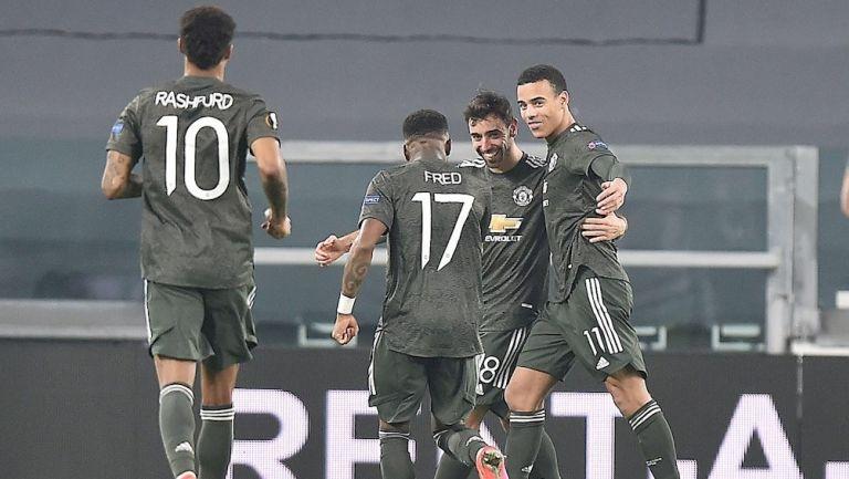 Jugadores del United celebran gol vs la Real Sociedad