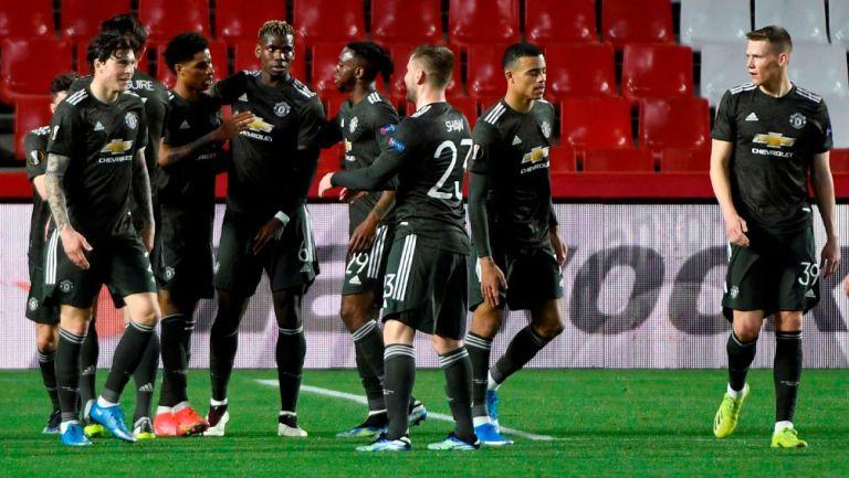 Jugadores del Manchester United celebran un gol ante Granada
