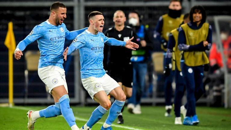 Jugadores del City celebran gol vs Dortmund