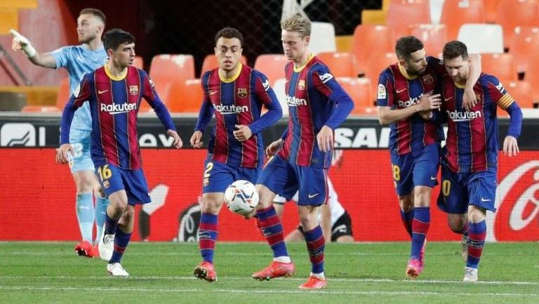 Jugadores culés en festejo de gol