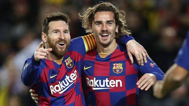 Griezmann y Messi durante un duelo con el Barcelona