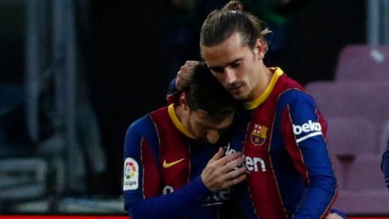 Lionel Messi y Antoine Griezmann en un partido con el Barcelona