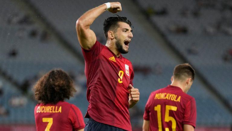 Jugadores de España celebran ante Costa de Marfil