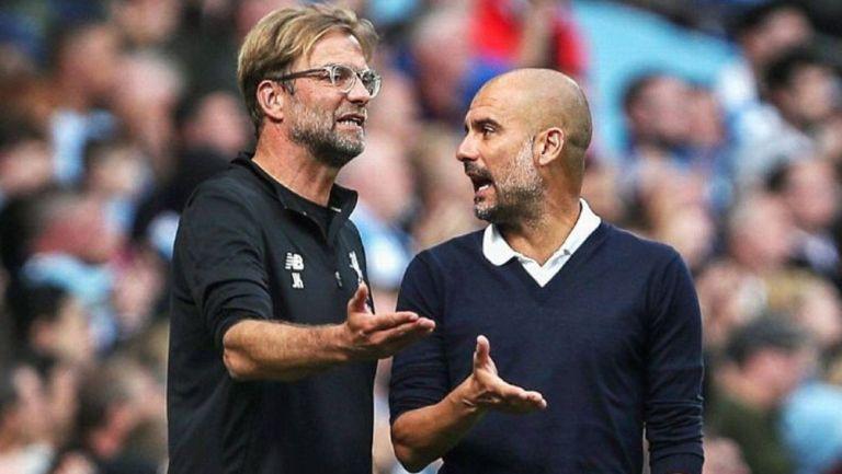 Jürgen Klopp y Pep Guardiola en partido de la Premier